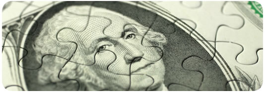 Face of dollar bill cut like a puzzle